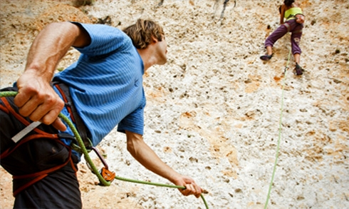 One person climbing, one person belaying